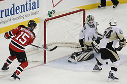 Dec 30, 2009; Newark, NJ, USA; Pittsburgh Penguins goalie Brent Johnson (1) makes a save while New Jersey Devils right wing Jamie Langenbrunner (15) looks for the rebound during the third period at the Prudential Center. The Devils defeated the Penguins 2-0.