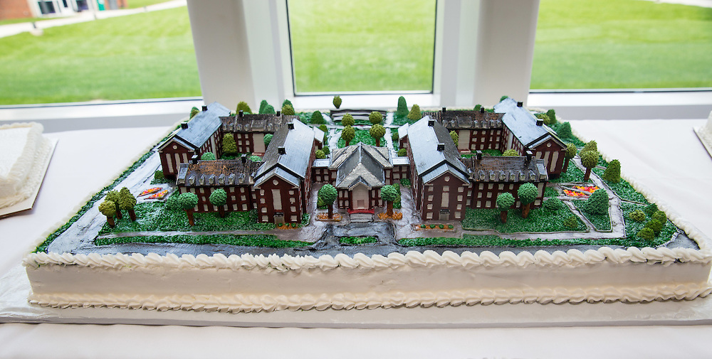 A 3D printed viersion of the new resident halls on South Green adorn the cake at the new residential housing grand opening.