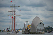The Loth Lorien passing the Thames Barrier - Royal Greenwich Tall Ships Festival with a fleet of square rigged ships moored on the Thames at Greenwich and Woolwich. The fleet includes two of the biggest Class A Tall Ships - the Dar Mlodziezy and Santa Maria Manuela - which are moored on Tall Ships Island in the river off Greenwich. Tall Ships Festival Day on Saturday 29 August featured free family entertainment and the chance to enjoy a taste of life on the high seas.