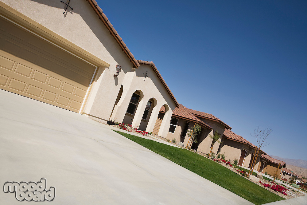 New House With Large Garage and Arched Entry