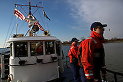 The U.S. Coast guard prepares to dock their boat after patrolling the Potomac River as a part of security measures taken for the Presidential Inauguration ceremonies in Washington, D.C., on January 21, 2013.