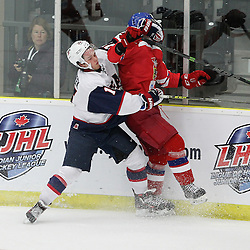 COBOURG, - Dec 14, 2015 -  Game #3 - United States vs Czech Republic at the 2015 World Junior A Challenge at the Cobourg Community Centre, ON. Grant Jozefek #15 of Team United States makes the hit on the Czech Republic player during the second period.(Photo: Tim Bates / OJHL Images)