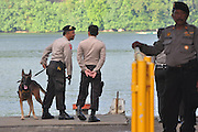 CILACAP, INDONESIA - APRIL 28: <br /> <br /> Ambulances Carrying Coffins For Death Penalty<br /> <br /> Indonesia police prepare death pebalty of drugs at Wijayapura port on April 28, 2015 in Cilacap, Central Java, Indonesia.<br /> Condemned Bali Nine duo Andrew Chan and Myuran Sukumaran have been given 72 hours execution notice. The execution could be held as soon as Tuesday midnight on Nusukamban Island where they have been held, awaiting there fate since March 4th, 2015. Chan and Sukumaran were both sentenced to death after being found guilty of attempting to smuggle 8.3kg of heroin valued at around $4 million from Indonesia to Australia along with 7 other accomplices.<br /> ©Himawan Nugraha/Exclusivepix Media