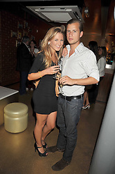 MILLIE BENNETT and GEORGE ASKEW at the launch party of the new Embargo 59 nightclub at 533 Kings Road, London on 25th June 2009.