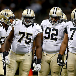 Aug 9, 2013; New Orleans, LA, USA; New Orleans Saints linebacker Rufus Johnson (59) and defensive end Tyrunn Walker (75) and defensive tackle John Jenkins (92) and defensive end Glenn Foster (74) against the Kansas City Chiefs during a preseason game at the Mercedes-Benz Superdome. The Saints defeated the Chiefs 17-13. Mandatory Credit: Derick E. Hingle-USA TODAY Sports