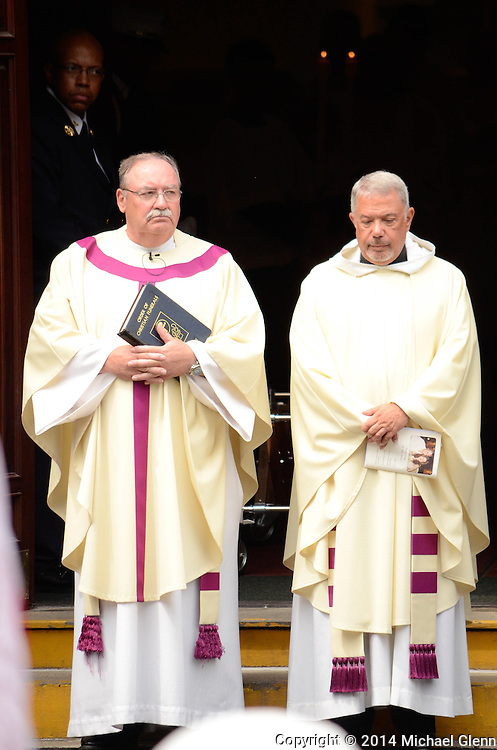 Staten Island, New York - July 10: The Priest and the Deacon of St Clares awaits the procession at the Funeral of Lt Gordon M. Ambelas L119 at Saint Clares Church on July 10, 2014 in New York, New York. Photo Credit: Michael Glenn / Glenn Images
