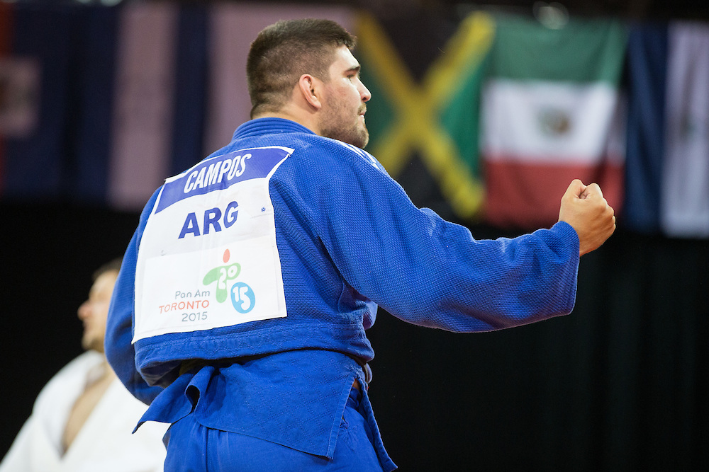 Hector Campos (L) of Argentina celebrates after defeating Manuel Bueno of Uruguay to win their bronze medal contest in the  mens judo -100kg class at the 2015 Pan American Games in Toronto, Canada, July 14,  2015.  AFP PHOTO/GEOFF ROBINS