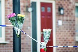 © Licensed to London News Pictures. 03/02/2016. Allerton Bywater UK. Flowers have been laid at the scene of a police investigation that is still underway at a property on Beeston Way in Allerton Bywater after the bodies of two children & a woman were found at the property. Photo credit: Andrew McCaren/LNP