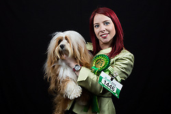 © Licensed to London News Pictures. 10/03/2016. Birmingham, UK. Olivia Carty with her Cavanese dog named Maro at Crufts 2016 held at the NEC in Birmingham, West Midlands, UK. The world's largest dog show, Crufts is this year celebrating it's 125th anniversary. The annual event is organised and hosted by the Kennel Club and has been running since 1891. Photo credit : Ian Hinchliffe/LNP