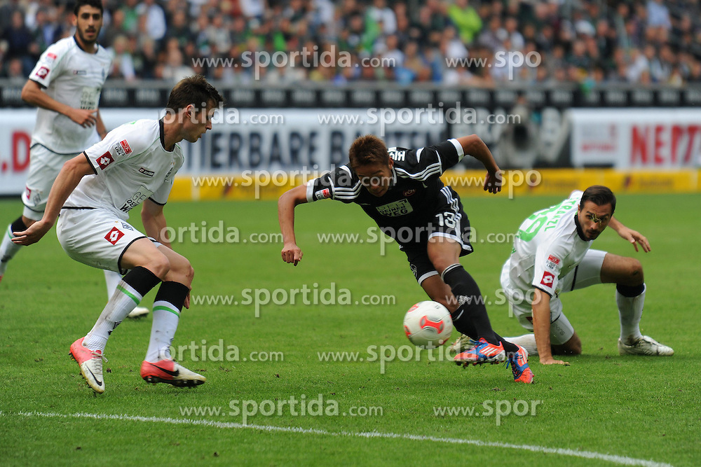 15.09.2012, Borussia Park, Moenchengladbach, GER, 1. FBL, Borussia Moenchengladbach vs 1. FC Nuernberg, 03. Runde, im Bild V.l.n.r. Harvard Nordtveit und Martin Stranzl ( beide Borussia Moenchengladbach ) koennen Hiroshi Kiyotake ( mitte 1 FC Nuernberg/ Action/ Aktion ) nicht auf seinem Weg zum 3 : 2 stoppen. // during the German Bundesliga 03rd round match between Borussia Moenchengladbach and 1. FC Nuernberg at the Borussia Park, Moenchengladbach, Germany on 2012/09/15. EXPA Pictures © 2012, PhotoCredit: EXPA/ Eibner/ Thomas Thienel..***** ATTENTION - OUT OF GER *****