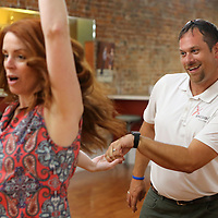 Jesse Bandre practices his dance moves with Tammy Wilson as they prepare for the upcoming Dancing Like the Stars Competition Thursday afternoon at The Dance Studio in Tupelo.