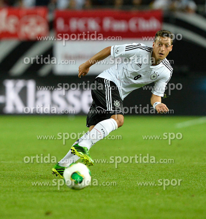 14.08.2013, Fritz Walter Stadion, Kaiserslautern, GER, Testspiel, Deutschland vs Paraguay, im Bild Mesut Oezil (GER) am Ball Freisteller, Einzelbild, Aktion // during the international friendly match between Germany and Paraguay at Fritz Walter Stadium, Kaiserslautern, Germany on 2013/08/14. EXPA Pictures &copy; 2013, PhotoCredit: EXPA/ Eibner/ Michael Weber<br /> <br /> ***** ATTENTION - OUT OF GER *****
