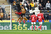 Hull City forward Fraizer Campbell (25) and Bristol City player Lloyd Kelly (17) during the EFL Sky Bet Championship match between Hull City and Bristol City at the KCOM Stadium, Kingston upon Hull, England on 5 May 2019.