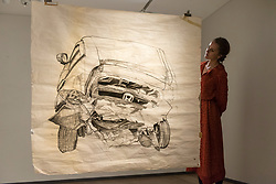 """© Licensed to London News Pictures. 20/11/2018. LONDON, UK. A staff member views """"Car Crash 3"""", 2017, by Aysha Almoayyed.  Preview of """"Accumulation:  Legacy and Memory"""", an exhibition presented by Art Bahrain Across Borders during Bahrain Art Week.  Works from 11 emerging and established Bahraini artists is on display 20th to 26 November at Alon Zakaim Fine Art gallery in Mayfair.  Photo credit: Stephen Chung/LNP"""