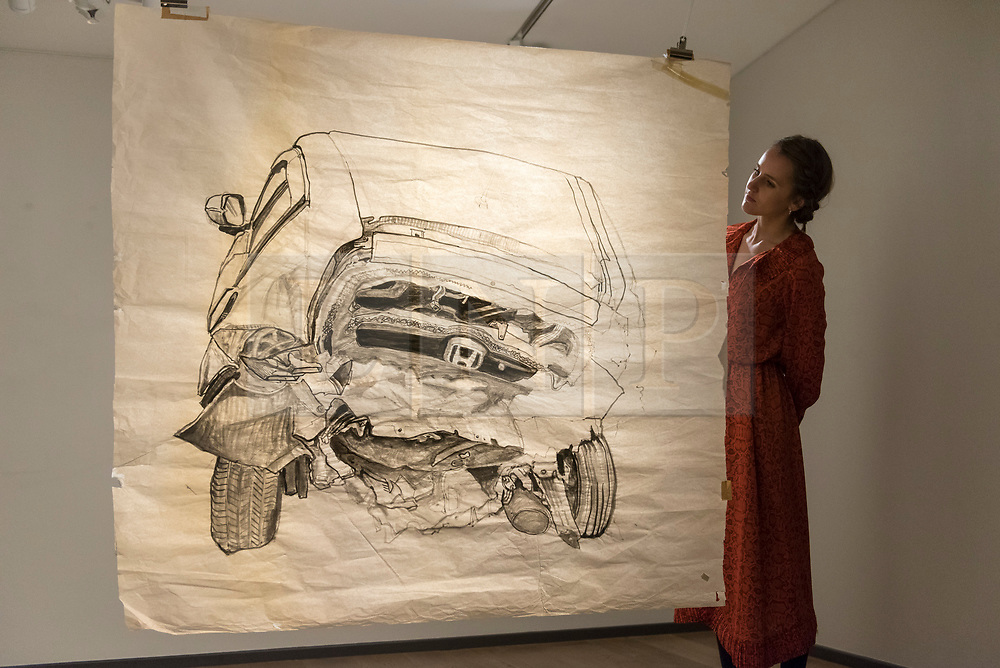 "© Licensed to London News Pictures. 20/11/2018. LONDON, UK. A staff member views ""Car Crash 3"", 2017, by Aysha Almoayyed.  Preview of ""Accumulation:  Legacy and Memory"", an exhibition presented by Art Bahrain Across Borders during Bahrain Art Week.  Works from 11 emerging and established Bahraini artists is on display 20th to 26 November at Alon Zakaim Fine Art gallery in Mayfair.  Photo credit: Stephen Chung/LNP"