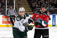 KELOWNA, BC - SEPTEMBER 28:  Jacob Wright #11 of the Everett Silvertips stick checks Kyle Crosbie #18 of the Kelowna Rockets  at Prospera Place on September 28, 2019 in Kelowna, Canada. (Photo by Marissa Baecker/Shoot the Breeze)