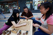 Young people playing go.