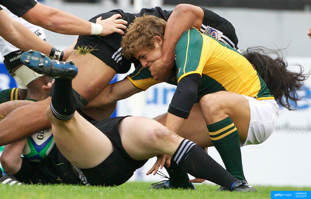 Patrick Lambie, South Africa, is tackled by the New Zealand defence during the New Zealand V South Africa semi final match at Estadio El Coloso del Parque, Rosario, Argentina, during the IRB Junior World Championships. 17th June 2010. Photo Tim Clayton....