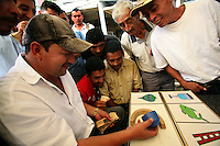 Men bet on a game of chance at the market in El Palmar, a small remote village in the southern Colombian state of Nariño, on Saturday, June 23, 2007. (Photo/Scott Dalton)