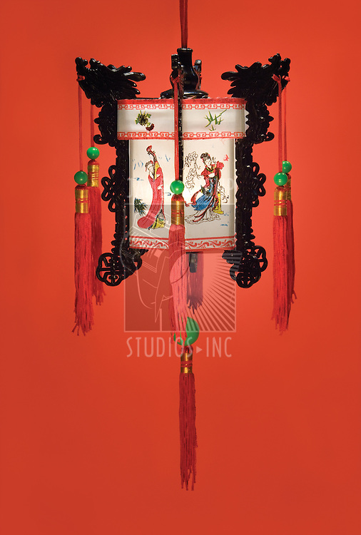 Traditional hanging Chinese lantern on a red background