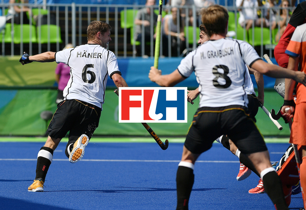 Germany's Martin Haner (L) celebrates after scoring a goal during the men's Bronze medal field hockey Netherlands vs Germany match of the Rio 2016 Olympics Games at the Olympic Hockey Centre in Rio de Janeiro on August 18, 2016. / AFP / Pascal GUYOT        (Photo credit should read PASCAL GUYOT/AFP/Getty Images)