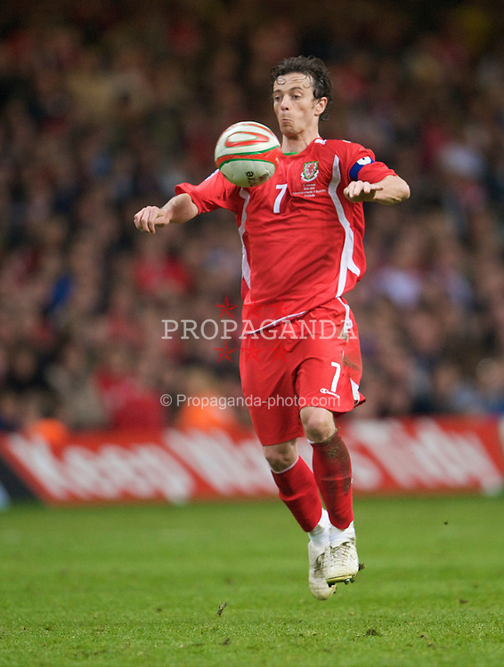 CARDIFF, WALES - Wednesday, April 1, 2009: Wales' captain Simon Davies in action against Germany during the 2010 FIFA World Cup Qualifying Group 4 match at the Millennium Stadium. (Pic by David Rawcliffe/Propaganda)