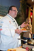 Chef Frank Benowitz, instructor at Mercer Community College, demonstrates how to safely prepare peach flambe at the Grand Market during the Atlantic City Food & Wine Festival.