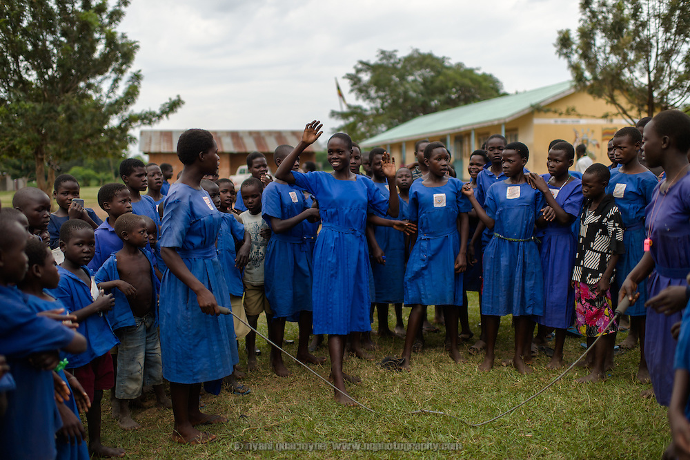 Viola Abachi, an Afripads user, skipping at Aputiri Primary School in Eastern Uganda on 31 July 2014. The school participates in a Menstrual Health Management program supported by Plan International, which includes the distribution of reusable sanitary pads made in Uganda by Afripads. Teachers report that absenteeism has fallen sharply, as girls who used rags or cotton wool previously would stay home for fear of leakage and embarrassment. Girls who use Afripads say that they are more comfortable now, and can run and play which they were afraid to do before when they had their periods.