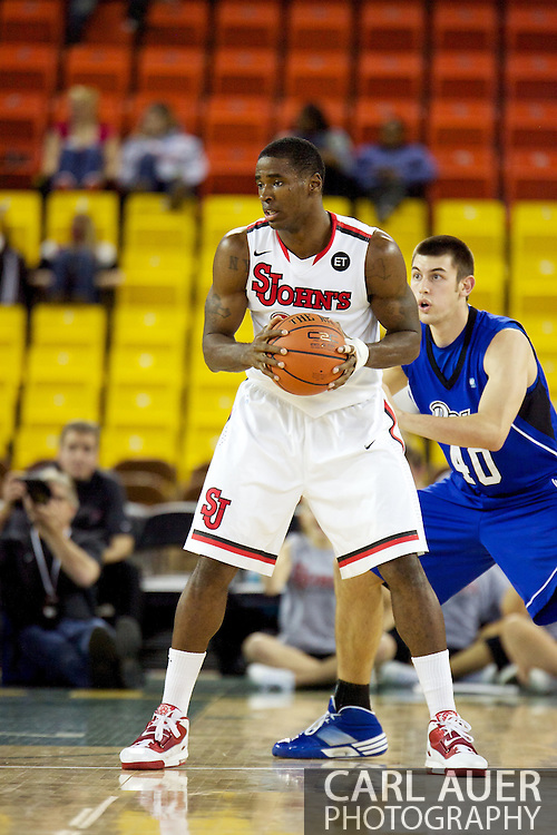November 26th, 2010:  Anchorage, Alaska - St. John's senior forward Justin Burrell (24) in the Red Storm's semi final game of the Great Alaska Shootout against the Drake Bulldogs.  The Red Storm defense held Drake to a tournament low score as St. Johns advanced to the final game 82-39.