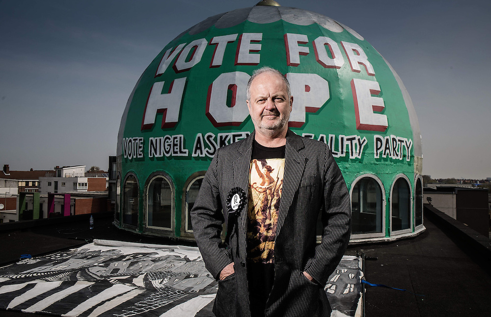 Nigel Askew of the Reality Party posers in front of a painting on Dalston Mosque on Friday 24 April. 2015.<br /> <br /> The Muslim community of Dalston have agreed to emblazon the dome of their mosque with a &lsquo;We are the Reality Party&rsquo; logo in support of Mark &lsquo;Bez&rsquo; Berry&rsquo;s candidate standing in Thanet South, Nigel Askew.<br />  <br /> Known as the Real Pub Landlord, Mr. Askew is well known to the Muslim community in Dalston.<br /> <br /> &ldquo;I am honoured the Muslim community of Dalston are making this wonderful gesture&rdquo;.<br /> <br /> &ldquo;&rsquo;We are the Reality Party&rsquo; is about inclusiveness, with all people standing together for responsible prosperity, and against injustice&rdquo;.<br />  <br /> &ldquo;South Thanet has been consumed with propaganda on immigration, spreading a message of fear and racial disharmony&rdquo;.<br />  <br /> &ldquo;The gesture from the Shacklewell Lane Mosque is a wonderful gesture that Britain must celebrate its diversity&rdquo;.<br />  <br /> The Shacklewell Lane Mosque was funded by the UK Turkish Islamic Association and was established in 1977 by Ramadan Guney and his wife Suheyla when it previously was a Synagogue.<br /> Photos Ki Price