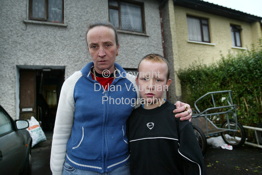 30/12/2003.Lorraine Doyle and her son Kevin aged 10 pictured at their home in Carlow.Kevin was shot by a pellet gun..Picture Dylan Vaughan.
