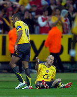 Photo: Richard Lane.<br />Arsenal v Barcelona. UEFA Champions League Final. 17/05/2006.<br />Arsenal's Freddie Ljungberg is consoled by Thierry Henry.