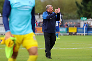 AFC Wimbledon manager Wally Downes walking off pitch clapping during the EFL Sky Bet League 1 match between AFC Wimbledon and Wycombe Wanderers at the Cherry Red Records Stadium, Kingston, England on 31 August 2019.