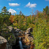 I traveled up to Maine to look for the beginning of fall foliage and possible new waterfall photography images. I found some early vibrant autumn colors at Screw Auger Falls in Grafton Notch State Park near Bethel, ME. Beaver Brook Falls. This waterfall is right off the street with easy access and makes for a great nature experience. Loved photographing this waterfall because it was somewhat remote and the early morning sun beautifully painted the trees and canopies framing the falls.     <br />