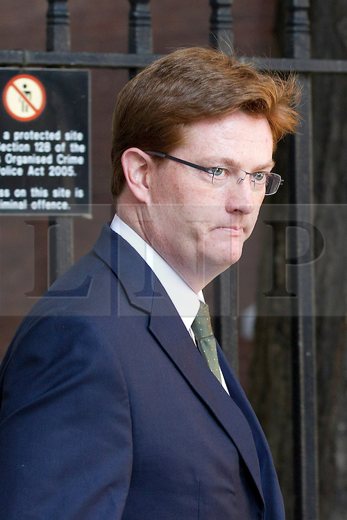 """© Licensed to London News Pictures. 29/08/2013. London, UK. Treasury Secretary Danny Alexander arrives for a meeting of the British cabinet on Downing Street in London today (29/08/2013) as a recalled British Parliament prepares to debate the possibility of """"direct"""" military action over recent reports an alleged chemical weapons attack in Syria. Photo credit: Matt Cetti-Roberts/LNP"""