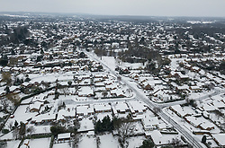 © Licensed to London News Pictures. 18/03/2018. Leatherhead, UK. Houses and gardens are covered in snow after overnight freezing temperatures.  Amber weather warnings remain in place for parts of the UK for a second day.  Photo credit: Peter Macdiarmid/LNP
