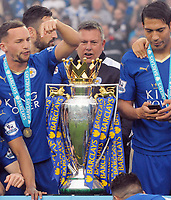 Football - 2015 / 2016 Premier League - Leicester City vs. Everton<br /> <br /> Leicester City coach Craig Shakespeare glances over at the trophy at the presentation at the King Power Stadium.<br /> <br /> COLORSPORT/ANDREW COWIE