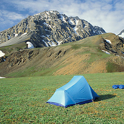Backpacking tent with mountains in Alaska