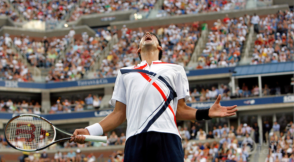 epa01115709 Novak Djokovic of Serbia reacts as he plays Roger Federer of Switzerland during the men's final on the last day of the 2007 US Open tennis tournament in Flushing Meadows, New York, USA, 09 September 2007.  EPA/JUSTIN LANE