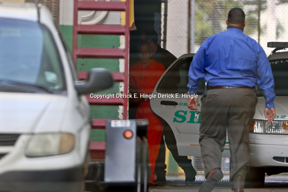 Robert Durst (orange jumpsuit) photographed through fencing is is escorted into Orleans Parish Criminal District Court before a extradition hearing on  Monday, March 16, 2015 in New Orleans. (Photo by: Derick E. Hingle for New York Post) OUT: NEW YORK TIMES, NEW YORK DAILY NEWS