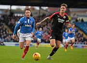Portsmouth striker Marc McNulty and Crawley Town Defender Sonny Bradley during the Sky Bet League 2 match between Portsmouth and Crawley Town at Fratton Park, Portsmouth, England on 2 January 2016. Photo by Adam Rivers.
