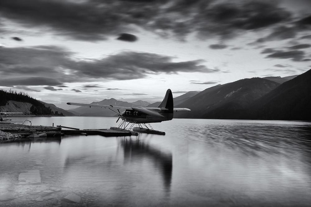 Muncho Lake black and white floatplane reflections