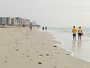 people walking along the beach Miami Beach USA