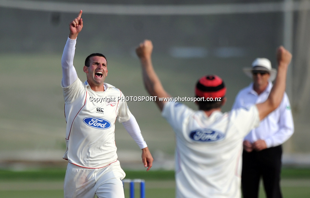 Canterbury bowler Andrew Ellis celebrates getting the wicket of Chris Martin and winning the game. Plunket Shield domestic cricket match, Auckland Aces v Canterbury Wizards. Colin Maiden Park, Auckland. Thursday 31 March 2011. Photo: Andrew Cornaga/photosport.co.nz