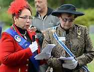 "SHANNAH08P<br /> Dr. Marion Lane (left) addresses the crowd as Bobbi McMullen stands by during a dedication ceremony honoring Hannah Till Saturday October 3, 2015 at Eden Cemetery in Collingdale, Pennsylvania. Hannah Till, a free black woman and unsung hero of the Revolutionary War who worked for Gens. George Washington and Lafayette is being honored as a ""Patriot"" by the Daughters of the American Revolution with a special ceremony and headstone dedication at Eden Cemetery, a historically-black cemetery in Collingdale. (William Thomas Cain/For The Inquirer)"