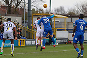 AFC Wimbledon striker Joe Pigott (39) battles for possession with Burton Albion defender Jake Buxton (3) during the EFL Sky Bet League 1 match between AFC Wimbledon and Burton Albion at the Cherry Red Records Stadium, Kingston, England on 9 February 2019.