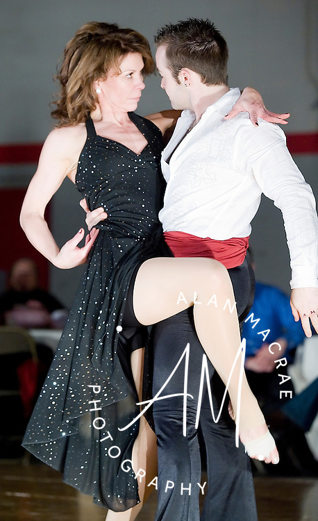 Laconia Police Sergeant Sharon Cavanaugh and her dance partner Ian Jameson delivered a steaming Pasa Doble routine in Saturday's Dancing with the Local Stars program at the Laconia Middle School.  (Alan MacRae/for the Citizen)