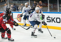 Jason Demers of Canada vs Stephane da Costa of France during the 2017 IIHF Men's World Championship group B Ice hockey match between National Teams of Canada and France, on May 11, 2017 in AccorHotels Arena in Paris, France. Photo by Vid Ponikvar / Sportida
