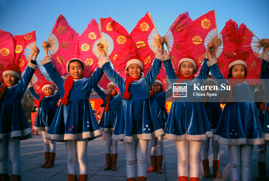 Girls' dance with red fan to celebrate Chinese New Year, China
