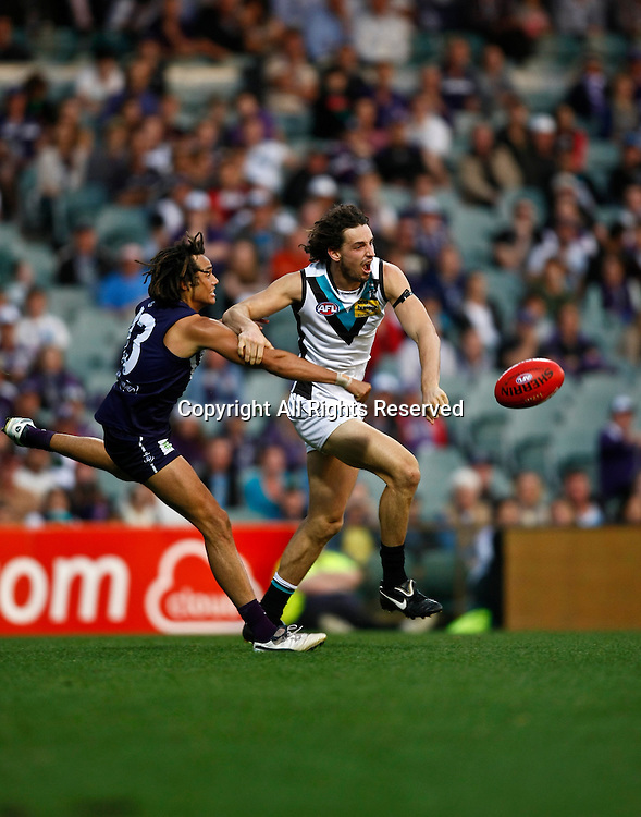 13.05.2012 Subiaco, Australia. Fremantle v Port Adelaide. John Butcher (R) and Tendai Mzungu (L) in action during the Round 7 game played at Patersons Stadium.